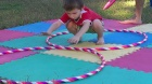 Boy plays with Circo Hoop at the park