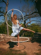 Circo Hoop showcases white three piece collapsible hoops.  All of the pieces fit together interchangeably making the hoop totally customizable.